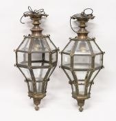 A VERY GOOD PAIR OF CONTINENTAL OCTAGONAL SHAPED BRASS HANGING LANTERNS with bevelled glass