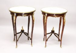 A GOOD PAIR OF LOUIS XVITH DESIGN FRENCH CIRCULAR MARBLE TOP TABLE with ormolu mounts, curving