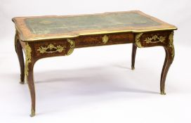 A LATE 19TH CENTURY FRENCH KINGWOOD, MARQUETRY AND ORMOLU BUREAU PLAT, with tooled green leather