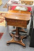 A GOOD REGENCY ROSEWOOD TEAPOY, with rising top, the interior with two lidded compartments and a