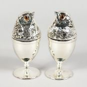 A GOOD PAIR OF SILVER PLATE CHICK EGG CUPS.