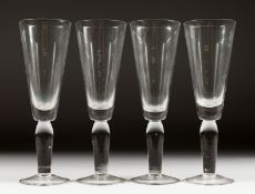 FOUR HEAVY TALL ALE GLASSES.