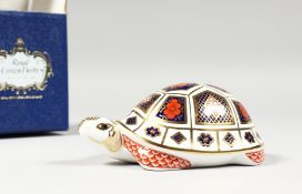 A ROYAL CROWN DERBY TURTLE PAPERWEIGHT with gold stopper, box and certificate.