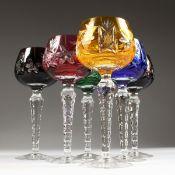 SIX HARLEQUIN COLOURED CUT CRYSTAL HOCK GLASSES.