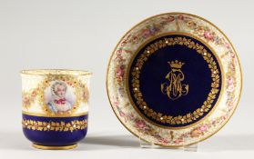 A SEVRES CRESTED RICH BLUE CUP AND SAUCER. Sevres mark in blue.