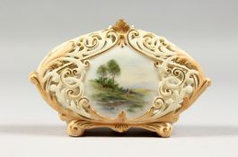 AN EARLY 19TH CENTURY LOCKE AND CO. WORCESTER BLUSH IVORY VASE with pierced body painted with a