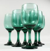 SIX LARGE GREEN WINE GLASSES.