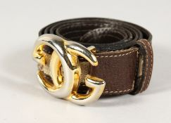 A BROWN LEATHER AND FABRIC GUCCI BELT with gilt GG.