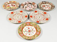 A MODERN SET OF FOUR ROYAL CROWN DERBY coloured Imari style plates and two Abbeydale Imperial