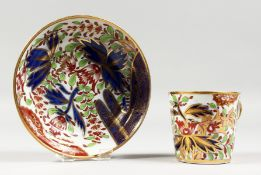 AN EARLY 19TH CENTURY CHAMBERLAIN WORCESTER RING HANDLED CUP AND SAUCER painted in an Imari style