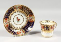 AN EARLY 19TH CENTURY CHAMBERLAIN WORCESTER CUP AND SAUCER painted in an Imari style pattern 293.