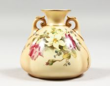 A ROYAL WORCESTER BLUSH IVORY TWO HANDLED VASE painted with roses and lilies, date code 1914,