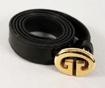 A GUCCI BLACK LEATHER BELT with gilt GUCCI.