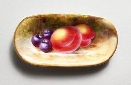 A ROYAL WORCESTER SMALL OVAL DISH painted with fruit, date code 1939.