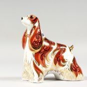 A ROYAL CROWN DERBY AMERICAN SPANIEL DOG PAPERWEIGHT, gold stopper and box.