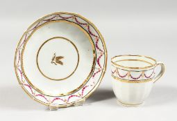 AN 18TH CENTURY WORCESTER TYPE SPIRALLY MOULDED COFFEE CUP AND SAUCER, a continuous band of