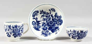 AN 18TH CENTURY WORCESTER COFFEE CUP, TEA BOWL AND SAUCER painted with the three flowers pattern.