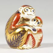 A ROYAL CROWN DERBY PAPERWEIGHT MONKEY and baby, gold stopper and box.