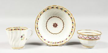 A LATE 18TH CENTURY NEW HALL TYPE FACETED COFFEE CUP, TEA BOWL AND SAUCER painted with puce festoons