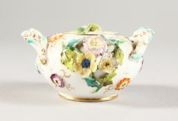 A MINIATURE COALPORT FLOWER ENCRUSTED TWO-HANDLED SUCRIER AND COVER. 3ins diameter.