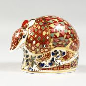 A ROYAL CROWN DERBY PAPERWEIGHT ARMADILLO, gold stopper and box.