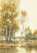 J. E. Grace (1851-1908) British, A river scene with reeds and trees and cows in a field beyond,