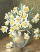 Marion Broom (1878-1962) British, A still life of a jug filled with daffodils, watercolour,