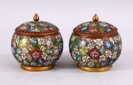A PAIR OF CHINESE CLOISONNE LIDDED JARS, each decorated with raised floral decoration, 9cm high x