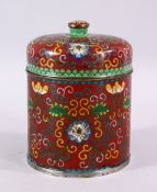 A 19TH / 20TH CENTURY CHINESE CLOISONNE CYLINDRICAL BOX AND COVER, decorated upon a red ground
