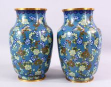 A LARGE PAIR OF 19TH / 20TH CENTURY CHINESE CLOISONNE VASES, each decorate with an array of flora