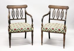 A GOOD PAIR OF REGENCY MAHOGANY ARMCHAIRS, with triple pierced oval splats, reeded arms, padded