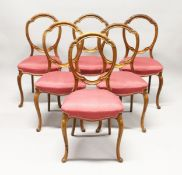 A GOOD SET OF SIX VICTORIAN CABRIOLE LEG DINING CHAIRS with padded seats.