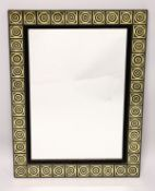 A RECTANGULAR WALL MIRROR, with black and gilt decorated frame. 2ft 9ins x 2ft 1ins.