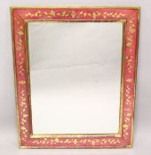 A RECTANGULAR WALL MIRROR, with red painted and gilt decorated frame. 3ft 2ins x 2ft 7ins.