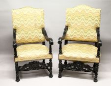 A MATCHED PAIR OF CARVED AND EBONISED JACOBEAN REVIVAL ARMCHAIRS, with upholstered backs and seats.