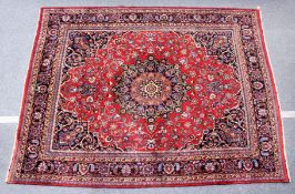 A PERSIAN CARPET, 20TH CENTURY, claret ground with allover stylised floral decoration. 11ft 4ins