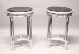 A PAIR OF OVAL SILVERED WOOD TABLES with marble tops.