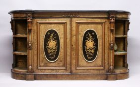 A GOOD VICTORIAN FIGURED WALNUT CREDENZA, with black marble top, the front fitted with a pair of