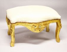 A GILTWOOD WINDOW SEAT with padded top.