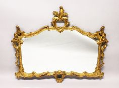 A CHIPPENDALE STYLE GILT FRAMED OVERMANTLE MIRROR, EARLY 20TH CENTURY, of ornate rococo form, with