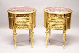 A GOOD PAIR OF GILTWOOD OVAL BEDSIDE CABINETS with marble tops.