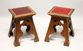 A GOOD PAIR OF OAK GOTHIC REVIVAL AESTHETIC MOVEMENT STOOLS, with upholstered square tops and