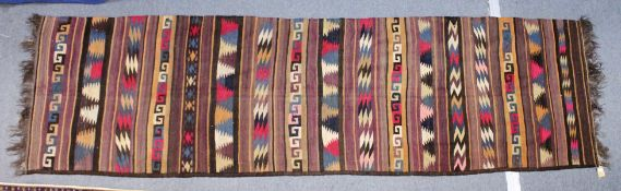 A FLATWEAVE KELIM RUNNER/HALL CARPET, with bands of Greek key and other geometric designs. 13ft 0ins