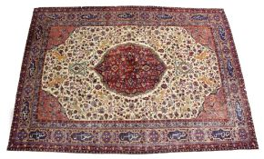 A GOOD PERSIAN CARPET, cream ground with central floral decorated crimson ground panel, the main