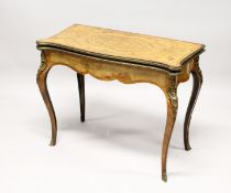 A GOOD VICTORIAN FIGURED WALNUT CARD TABLE, with quartered marquetry inlaid folding top, opening