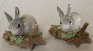 Two Lladro rabbits on naturalistic bases