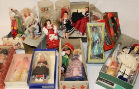 Quantity of vintage costume dolls & reproduction dolls pram