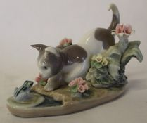Lladro cat staring at a frog