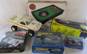 Scaletrix track extension, Scaletrix car, tabletop roulette, digital radio control system, poker set
