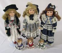 3 collectors dolls on stands with 3 miniature dolls